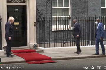 Gabonese President Ali Bongo Ondimba is aided as he walks towards the British Prime Minister